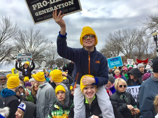 Andrew Shanahan, a McQuaid seventh-grader, sits on the shoulders of McQuaid eighth-grader Nick Lynch Friday at the March for Life in Washington, D.C.