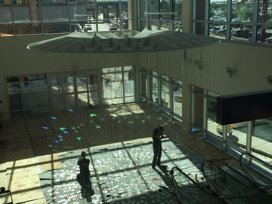 "Workers install the ""Radiance"" public art work at the El Paso International Airport."