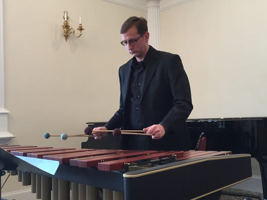 Hanover Symphony Orchestra conductor Timothy Bupp performs on marimba at the 9th Annual Taste of Chamber on Sunday, Jan. 29, 2017.