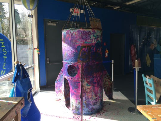 Young artists are invited to add to the layers of paint on this indoor rocket shape at The Muse.