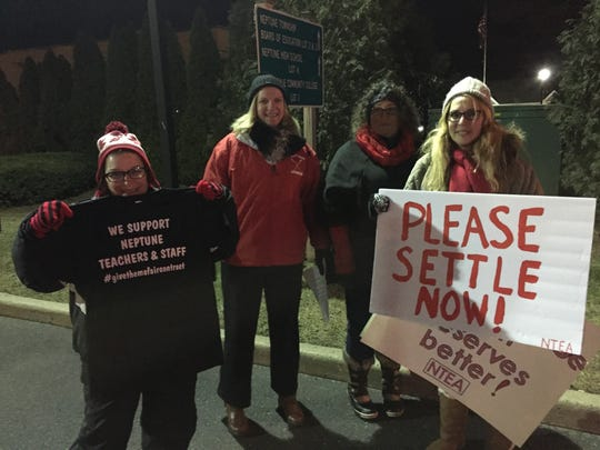 Neptune Township teachers and parents rallied Monday night in support of a new renegotiated contract.