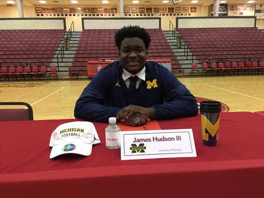 Toledo Central Catholic senior defensive lineman James Hudson III signs to play football at Michigan during a ceremony at his high school on Wednesday morning.