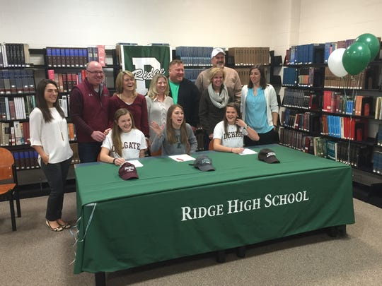 Ridge girls soccer players Julia Lyndsey, Olivia Melnyk and Ally Friedman (from left) sign their National Letters of Intent on Wednesday.