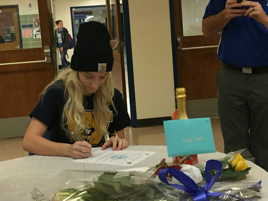 McNary senior Kayla Evans signs a national letter of intent to play women's soccer at Webster University on Feb. 1, 2017.