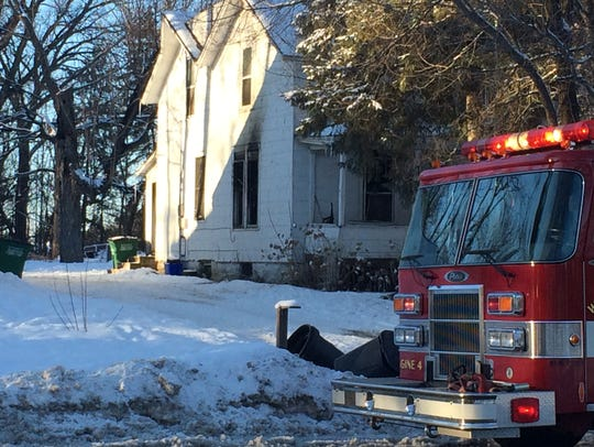 A fire truck sits in front of a Wisconsin Rapids duplex
