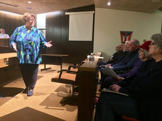 Realtor and broker Deanna Krieger expresses concerns about the impact of urban chickens on property values during a zoning committee meeting Thursday.