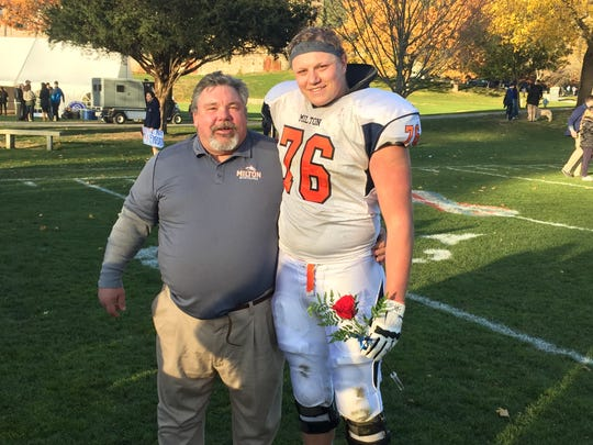 Millbrook native Allan Rappleyea poses with a coach at Milton Academy after a game last November.