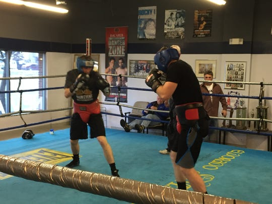 Tristan Harriman, left, and Zack Smith spar last year at the Nevada boxing gym in Reno.
