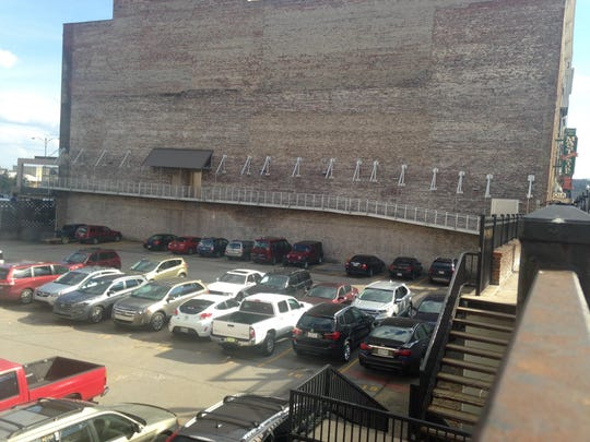 The site for the 10-story mixed-use condo building the Knoxville City Council approved a TIF for Tuesday is currently a parking lot on Gay Street. The building will provide two more levels of underground parking.