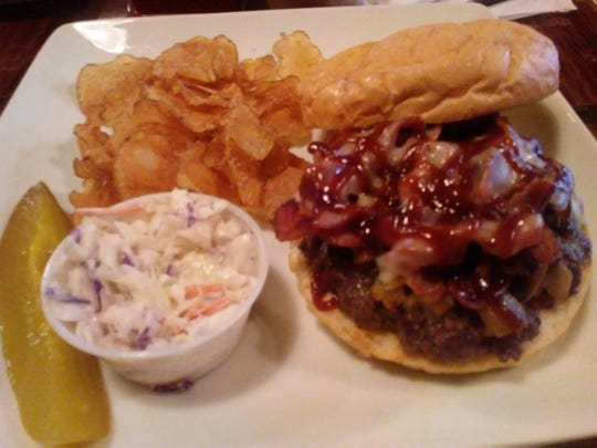 Taste of Grace Cafe's pepper-jack burger was a thick Angus beef patty topped with hickory smoked bacon, melted pepper jack cheese, mushrooms and caramelized onions crowned with a thin layer of sweet barbecue sauce. It was served with homemade chips and coleslaw.