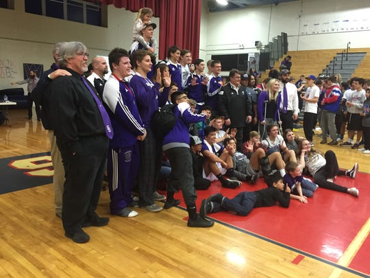 The Spanish Springs wrestling team celebrates its fifth
