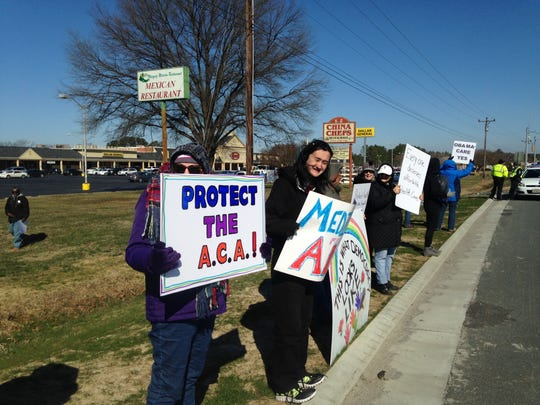 Around 50 supporters of the Affordable Care Act demonstrated