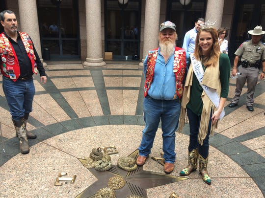 Snake handler Riley Sawyers and Miss Texas, Caroline Carothers of Plano.