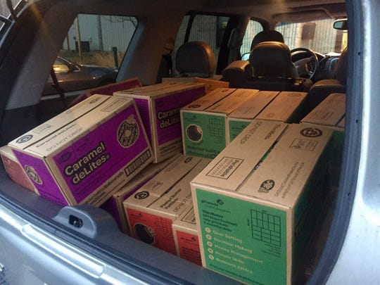 Cases of Girl Scout Cookies in the Creedons' car, ready to be unloaded at River Horse Brewing.
