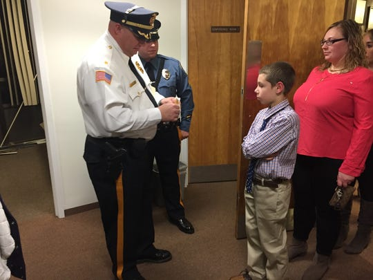 Millville police Chief Jody Farabella gives a junior