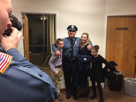 Sgt. John Bojaciuk embraces his wife and kids after