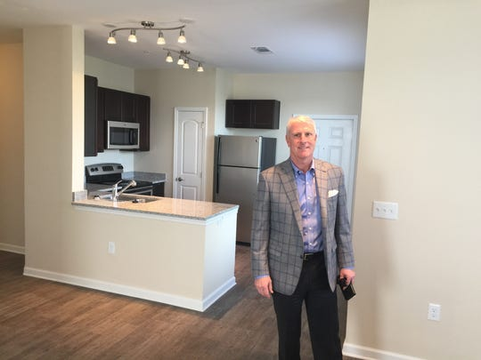 Developer Paul Murphy III stands in a new living room at The Villas on Wallace Road.