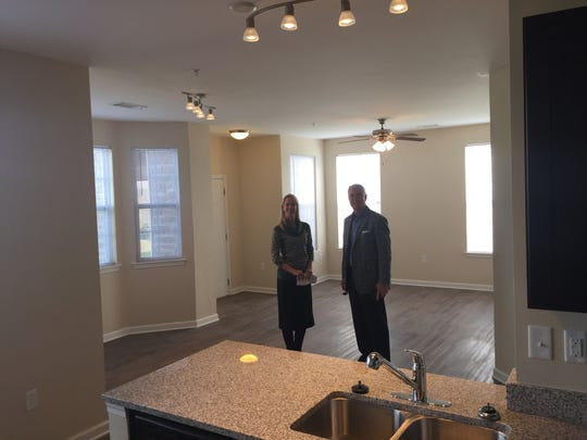 Tipton and Murphy show off a spacious living room at The Villas on Wallace Road.