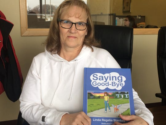 Author Linda Stanke holds the children's book she wrote