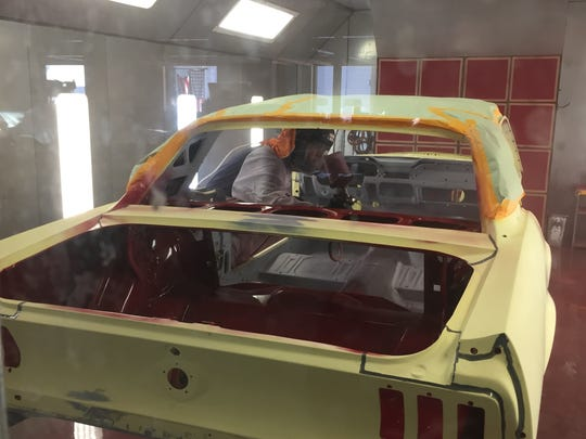 Jay Webb begins painting Harry Donovan's 1967 Mustang.