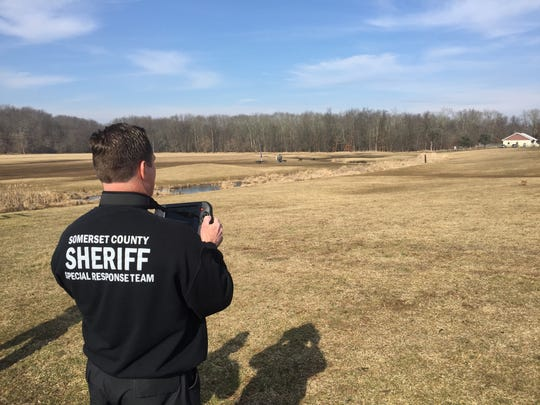 A Somerset County sheriff's officer demonstrates the