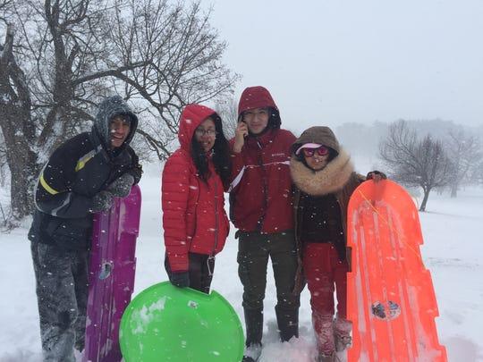 City of Poughkeepsie friends Axel Gomez, Daniela Santos, Marco Tellez and Abigail Bustamante go sledding in College Hill Park in Poughkeepsie.