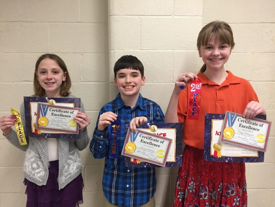 Sammy Humphrey, center, finished first in his class's