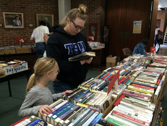 Customers search through the offerings at a past Friends of Morrisson-Reeves Library book sale.