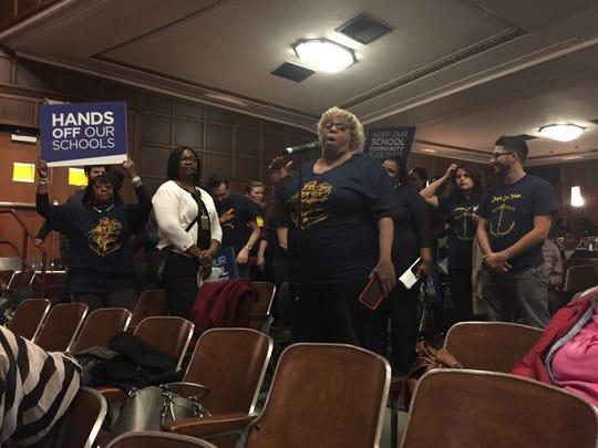 A Denby High School parent addresses the Detroit Public Schools Community District board of education at a meeting Feb. 14.