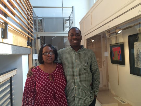 Derrick Freeman and his mother Angela Freeman-Hunter at the Emporium Center where his art is on exhibit through February.