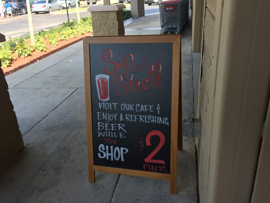 At Lucky's Market, shoppers can buy beer and wine to drink while they shop.