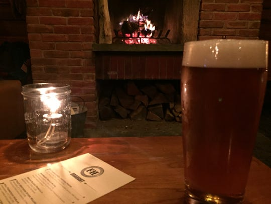 A cold lager and a warm fire at The Farmhouse Tap &