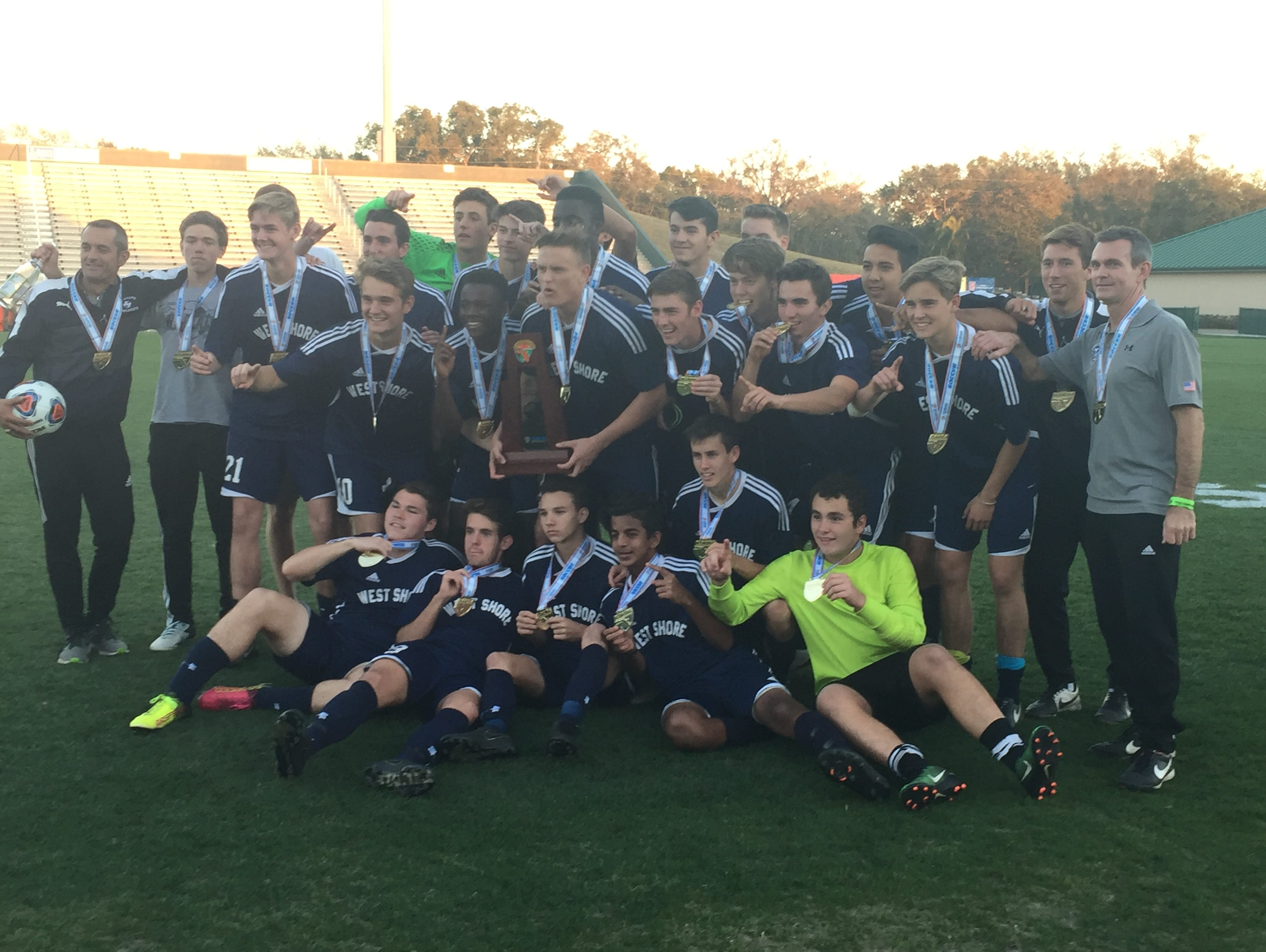 West Shore celebrates Thursday with the Class 2A state soccer trophy.