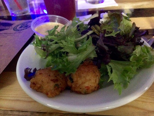 Shrimp boulettes, pickled jalapenos, and brie salad