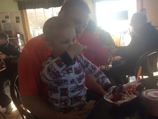 Luke Flowerette, 3, shares a sundae with his dad, Marcus