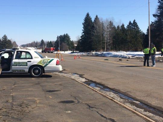 Kronenwetter police respond to scene of a fatal crash involving a utility truck.