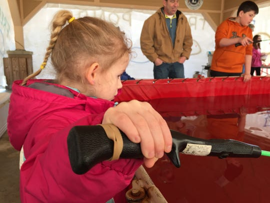 Emma Surdey, 4, fishes for trout on Saturday at the Pearl Beach Lions Club Winterfest.