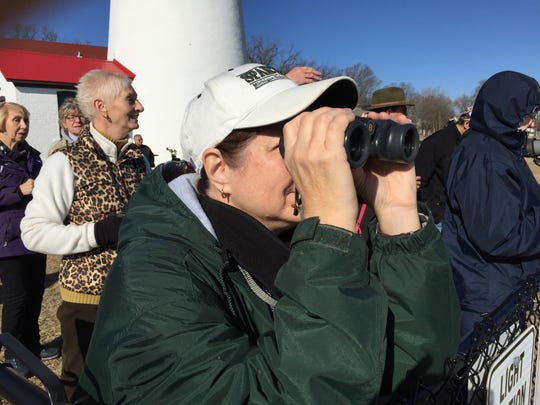 Liz Stange, from Allenton, looks at a flock of waterfowl during Saturday's Winter Bird Blast.