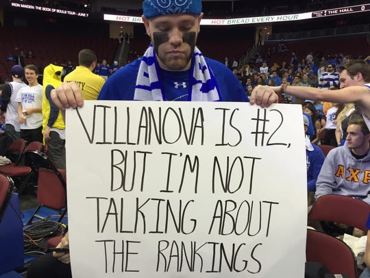 Seton Hall student-fan Tim Best holds up a sign for