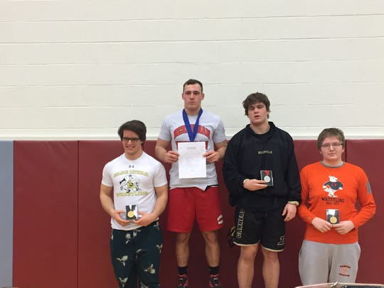 Bermudian's Dorian Steele accepts the 220-pound gold