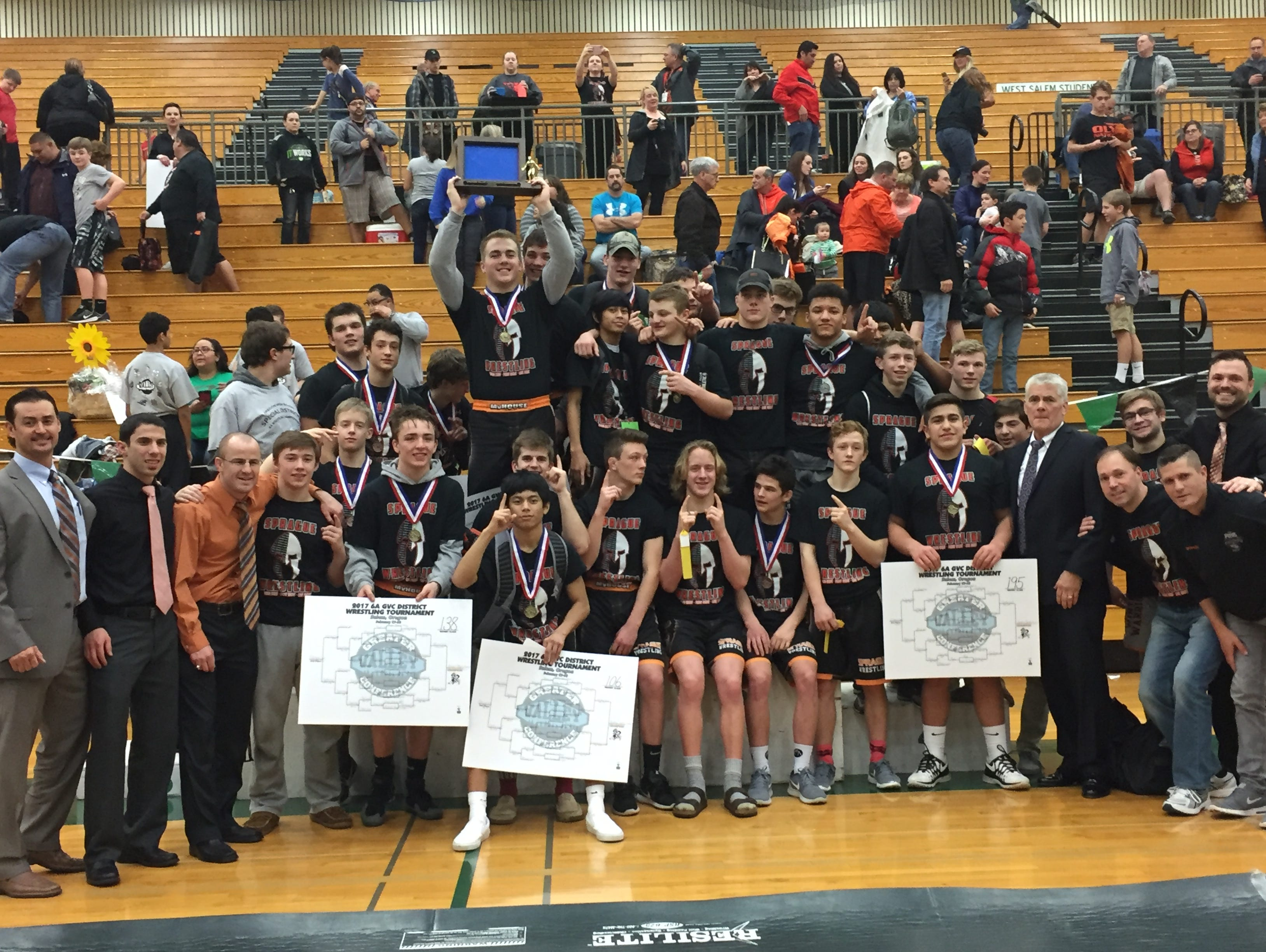 The Sprague High School wrestling team celebrates a fifth consecutive district championship.