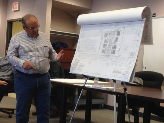 Engineer Michael Lanzafama details the proposal for eight single-family homes.