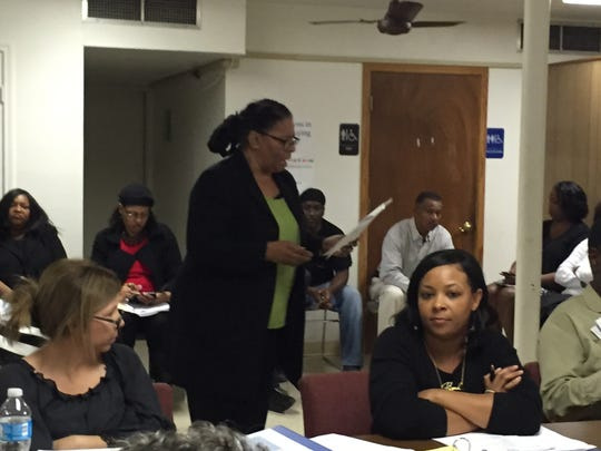Lafayette NAACP chapter president Marja Broussard, standing, asked the SMILE board in January 2017 to remove Africa Arceneaux, seated, from the board.