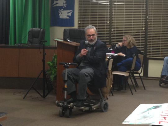"""Resident Joe Fine speaks during the meeting on the """"sanctuary city"""" issue."""