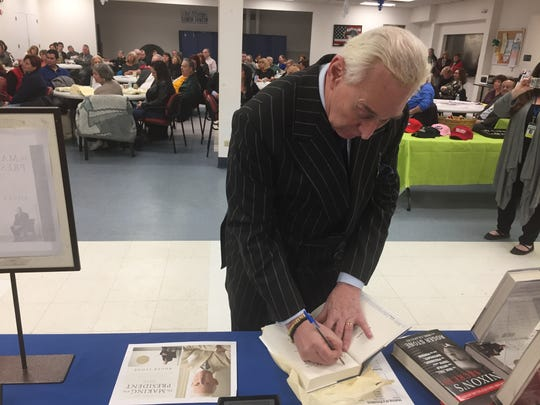 GOP operative Roger Stone autographing his new book on Trump's 2016 campaign at Old Bridge Senior Center, Feb. 22, 2017