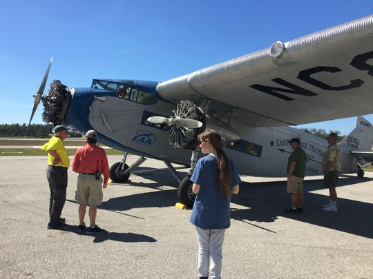 Local EAA members admire the iconic 1929 Ford Tri-Motor upon its arrival Monday afternoon, Feb. 20, 2017, at Naples Municipal Airport before pushing the 10,000-pound aircraft into a hangar.