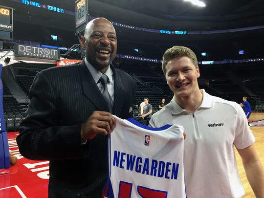Earl Cureton presents Josef Newgarden with a personalized Pistons jersey on Thursday night at the Palace.