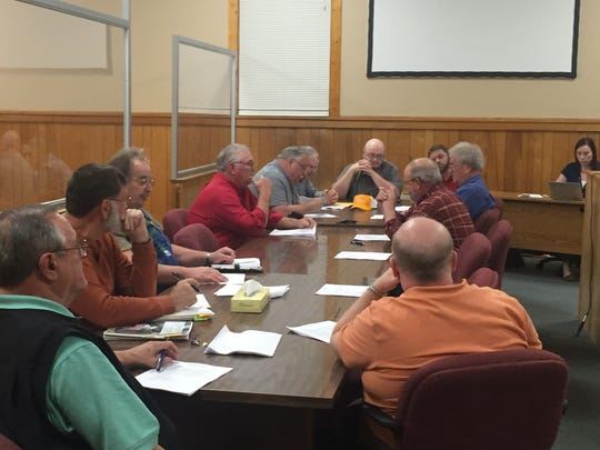 Stewart County commissioners discuss approving a lighting project of the school system.