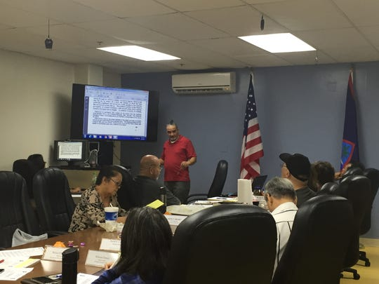 In this file photo, Guam Ancestral Lands Commission Chairman Anthony Ada explains the history of the estate of Jose Martinez Torres to the commissioners during a Feb. 22, 2017 meeting.
