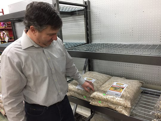 Bil Barrons at Angler's Outfitters in St. Clair said buying a premium bird seed mix will result in less mess and waste.